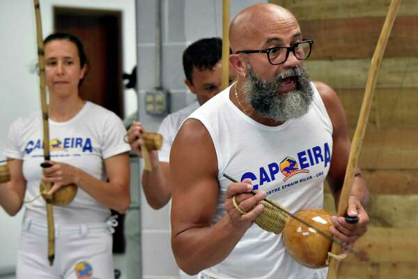 New Haven, Connecticut -Tuesday, July 16, 2019: Efrain Silva, the co-executive director of the Connecticut Capoeira & Dance Center in New Haven during a class capoeira session.
