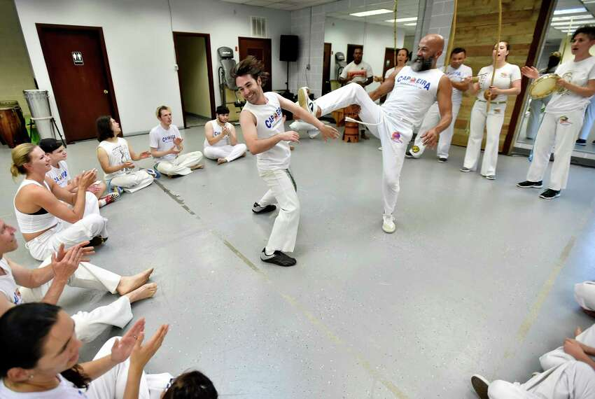 New Haven, Connecticut -Tuesday, July 16, 2019: Efrain Silva, the co-executive director of the Connecticut Capoeira & Dance Center in New Haven, bottom, and 13-year capoeira practitioner Jeff Herdle of West Haven perform a routine during a capoeira class session.