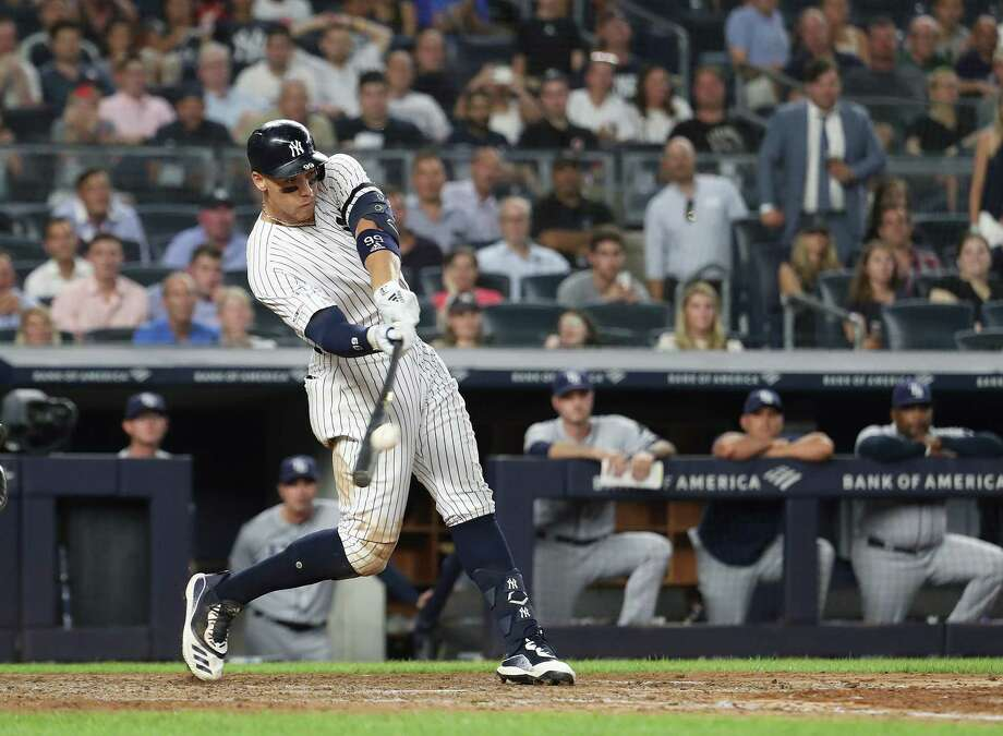 NEW YORK, NEW YORK - JULY 16:  Aaron Judge #99 of the New York Yankees hits the go ahead two run home run in the eighth inning against the Tampa Bay Rays during their at Yankee Stadium on July 16, 2019 in New York City. (Photo by Al Bello/Getty Images) Photo: Al Bello / 2019 Getty Images