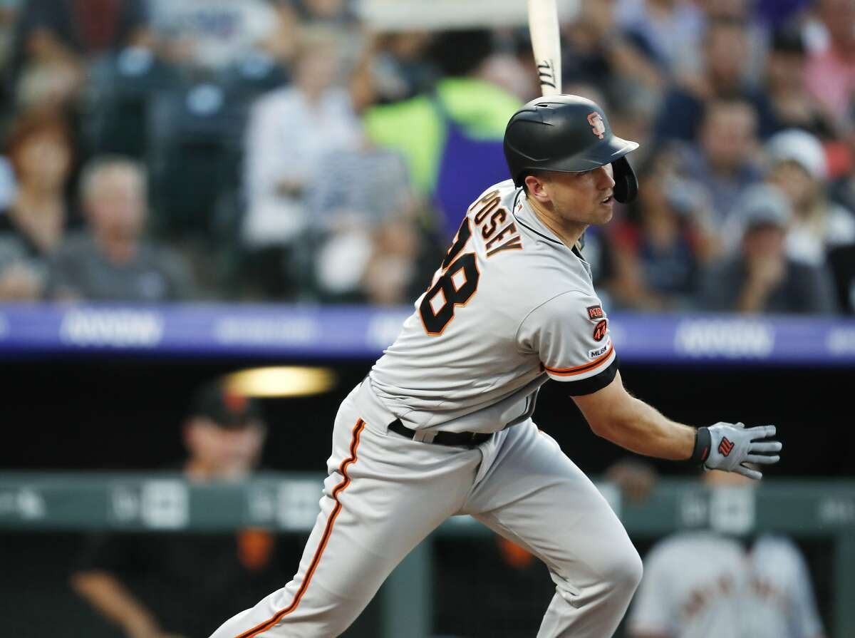 San Francisco Giants' Buster Posey singles against Colorado Rockies starting pitcher Peter Lambert during the sixth inning of a baseball game Tuesday, July 16, 2019, in Denver. (AP Photo/David Zalubowski)