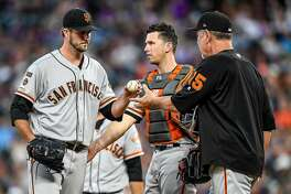 DENVER, CO - JULY 16: Drew Pomeranz #37 of the San Francisco Giants is taken out of the game by manager Bruce Bochy #15 with no outs in the sixth inning against the Colorado Rockies at Coors Field on July 16, 2019 in Denver, Colorado. (Photo by Dustin Bradford/Getty Images)