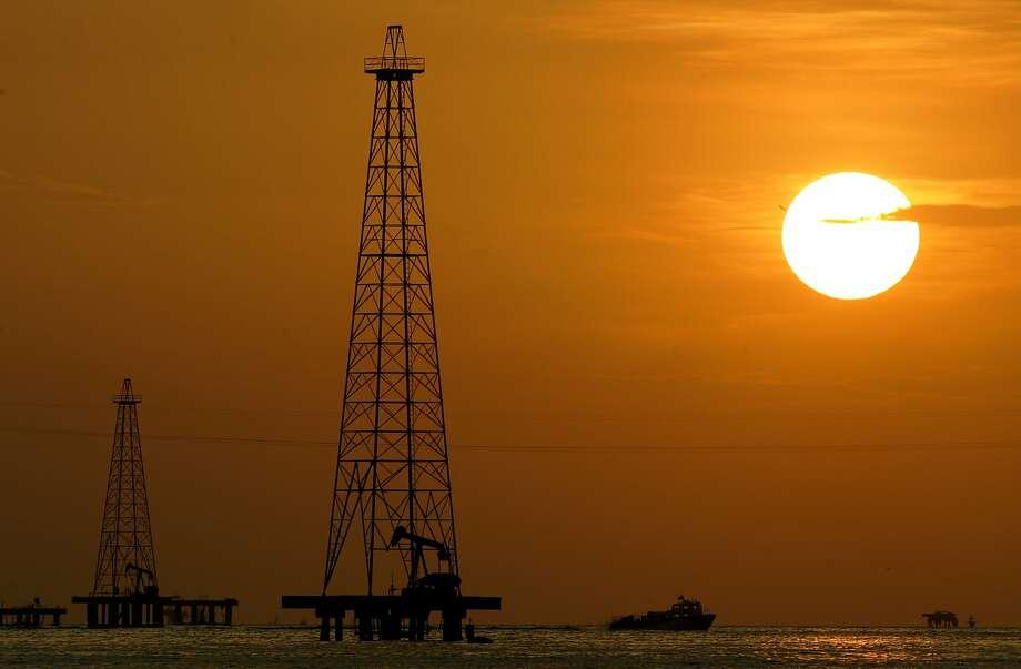 FILE - This Nov. 30, 2006 file photo shows oil drills in Maracaibo Lake in Venezuela's oil rich Zulia state. Photo: Leslie Mazoch, Associated Press