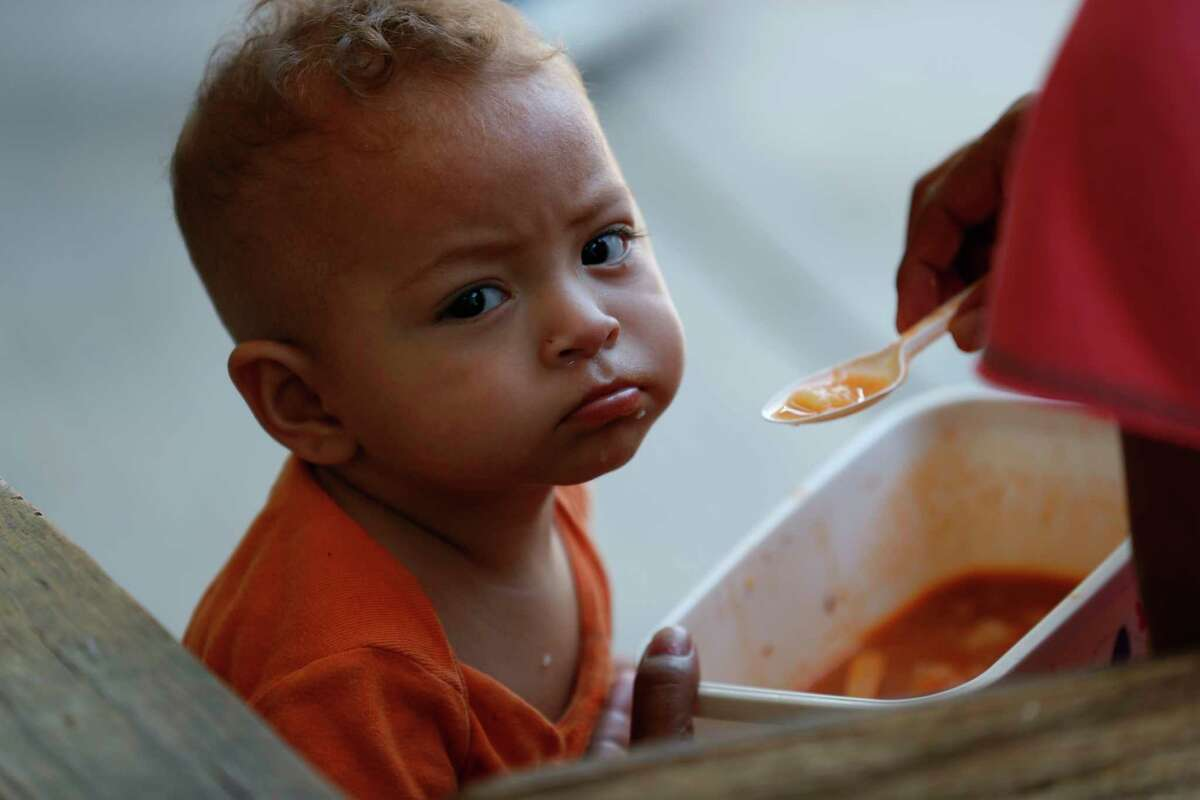 A migrant baby is given his lunch at the AMAR migrant shelter in Nuevo Laredo, Mexico, Tuesday, July 16, 2019. A U.S. policy to make asylum seekers wait in Mexico while their cases wind through clogged U.S. immigration courts has also expanded to the violent city of Nuevo Laredo.