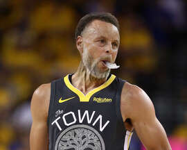 "Stephen Curry of the Golden State Warriors get the FaceApp ""Old Age"" filter treatment in this photo of him reacting against the Toronto Raptors in the first half during Game Six of the 2019 NBA Finals at Oracle Arena on June 13, 2019 in Oakland, California."