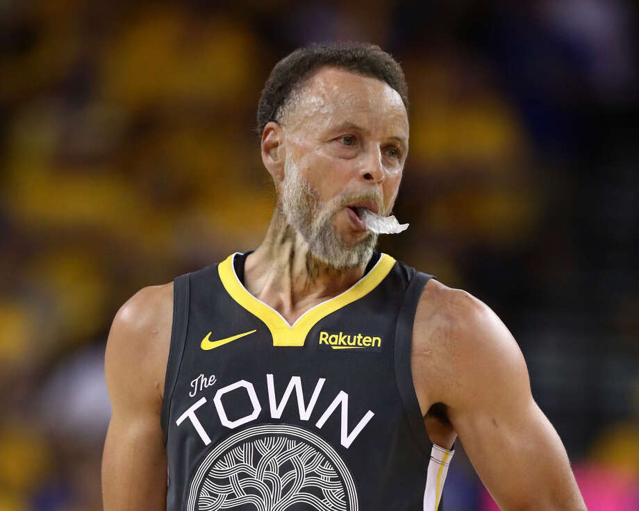 "Stephen Curry of the Golden State Warriors get the FaceApp ""Old Age"" filter treatment in this photo of him reacting against the Toronto Raptors in the first half during Game Six of the 2019 NBA Finals at Oracle Arena on June 13, 2019 in Oakland, Calif. Photo: Photo Illustration Using FaceApp,  Getty Images Photo"