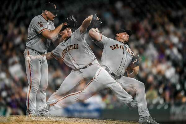 DENVER, CO - JULY 16: A multiple exposure image of Mark Melancon #41 of the San Francisco Giants as he pitches in the 10th inning of a game against the Colorado Rockies at Coors Field on July 16, 2019 in Denver, Colorado. (Photo by Dustin Bradford/Getty Images)
