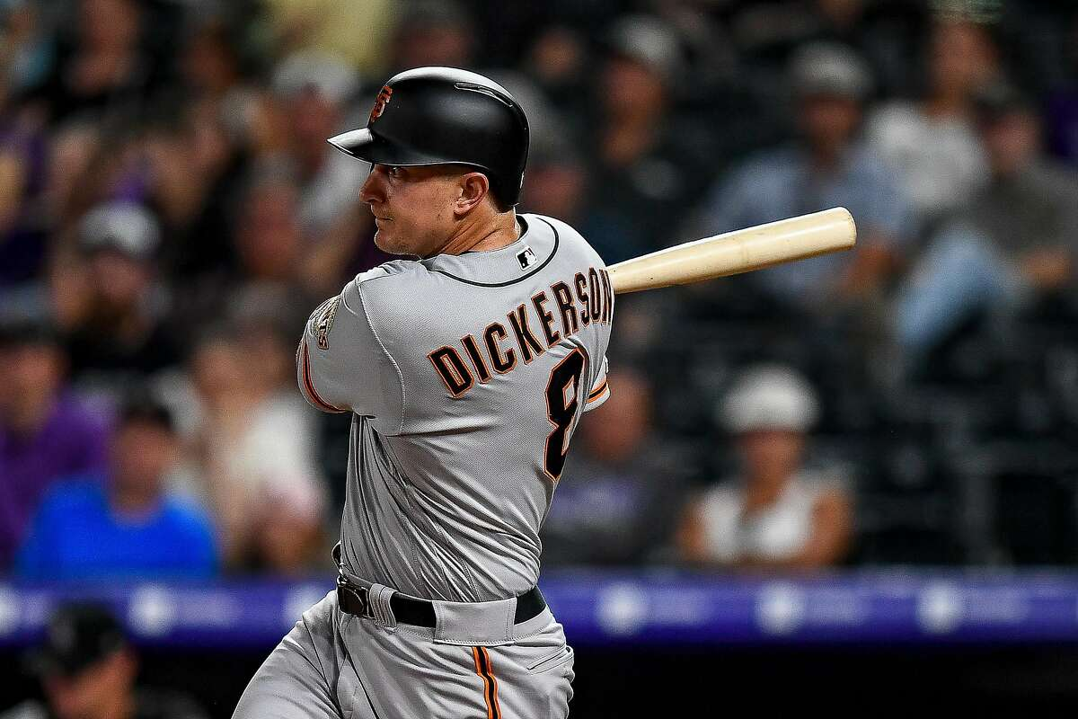 DENVER, CO - JULY 16: Alex Dickerson #8 of the San Francisco Giants hits a go-ahead RBI single in the 10th inning at Coors Field on July 16, 2019 in Denver, Colorado. (Photo by Dustin Bradford/Getty Images)