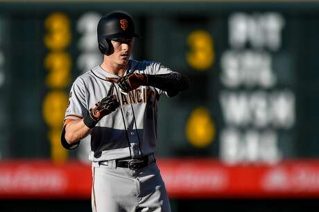 DENVER, CO - JULY 16: Mike Yastrzemski #5 of the San Francisco Giants signals to the dugout after hitting an RBI double in the second inning against the Colorado Rockies at Coors Field on July 16, 2019 in Denver, Colorado. (Photo by Dustin Bradford/Getty Images) Photo: Dustin Bradford / Getty Images