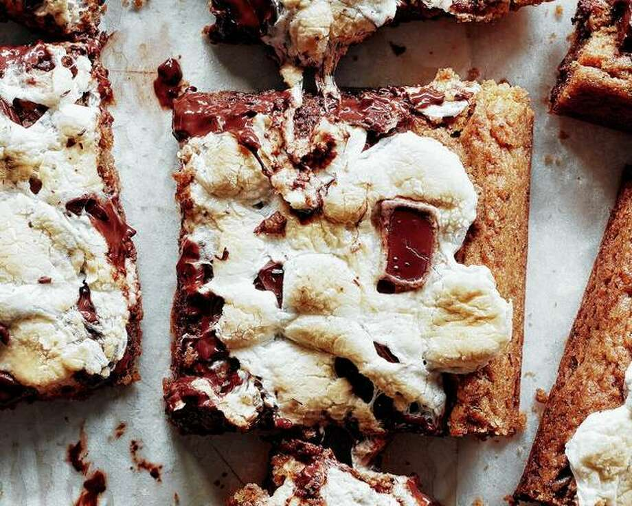 These messy-in-a-good-way blondies capture the essence of s'mores — toasted marshmallows, gooey chocolate, malty graham cracker flavor — in a home oven. Photo: Johnny Miller | The New York Times