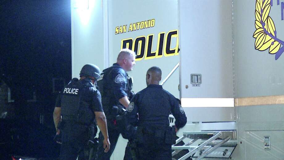 A standoff that lasted more than four hours ended peacefully with a wanted man in custody on the city's Southeast side, according to the San Antonio police. Photo: Ken Branca