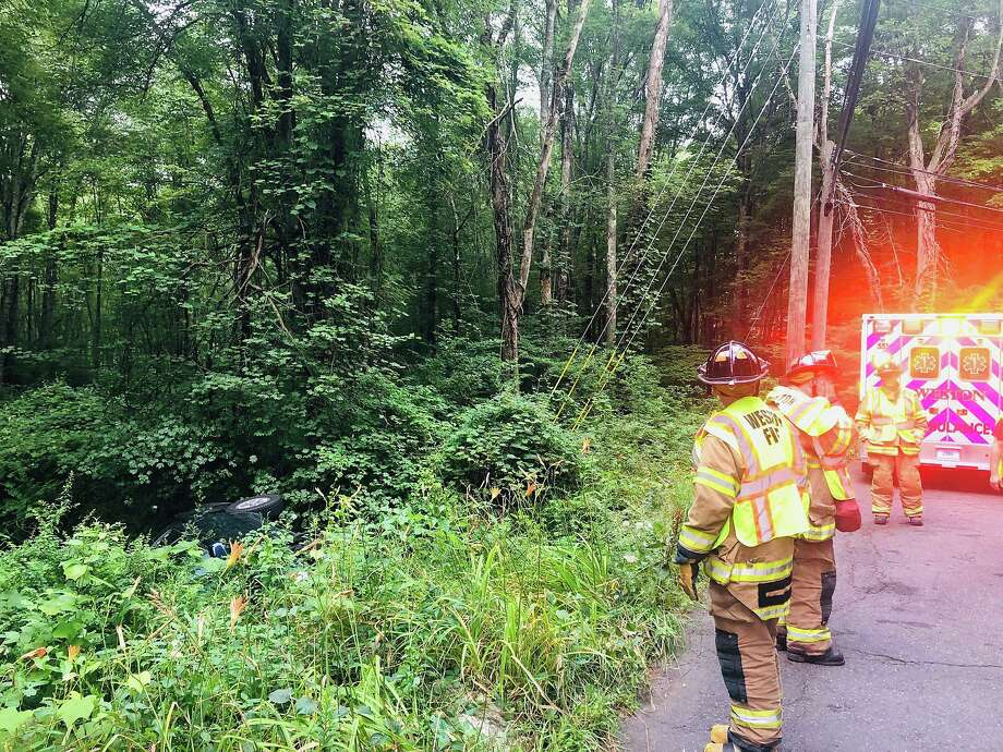 The Weston Fire Department and Weston Volunteer EMS responded to a single-car rollover accident on Godfrey Road West on Wednesday morning, July 17, 2019. The sole occupant of the vehicle was taken to Norwalk Hospital. Photo: Weston Fire Department Photo