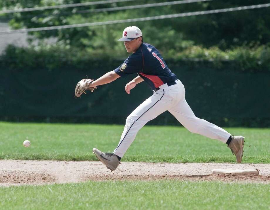 Daniel Bucciero tries to track down a ground ball during a recent Ridgefield American Legion 19U game. Photo: Scott Mullin / For Hearst Connecticut Media / Scott Mullin ownership