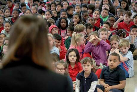 Durham Elementary School students listen as their principal, Dr. Amy Poerschke, is recognized as HISD's elementary principal of the year, Wednesday, Feb. 27, 2019, in Houston.
