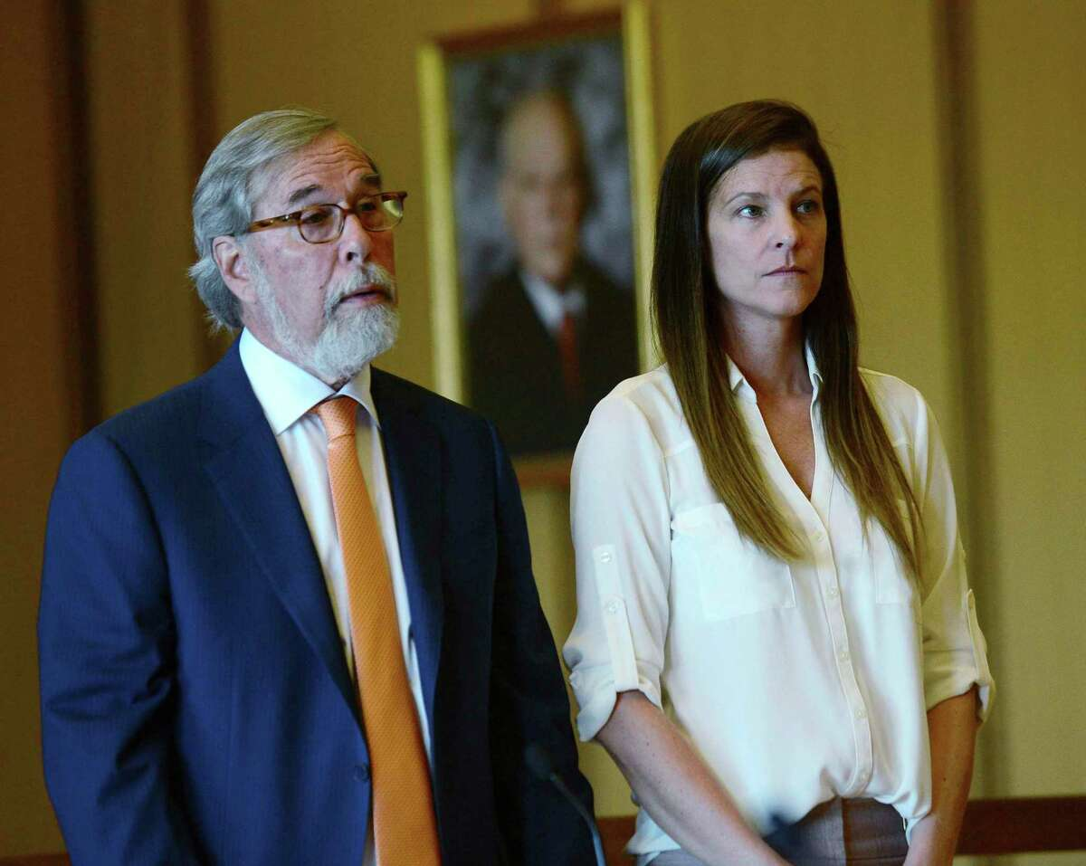 Michelle Troconis attends a hearing with her attorney Andrew Bowman in Stamford Superior Court in Stamford, Conn., on Friday, June 28, 2019. The judge agreed to issue a no-contact order designed to keep her boyfriend Fotis Dulos and his attorney away from her and also granted permission for her to travel to a friend's home in New York state. Troconis and Dulos are charged with evidence tampering and hindering prosecution in connection with the May 24 disappearance of Fotis Dulos's wife Jennifer Dulos. (Erik Trautmann /Hearst Connecticut Media via AP, Pool)