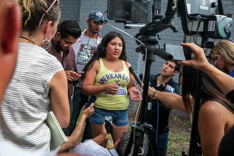 Kaylin Garcia, center, talks to reporters about the raid that was conducted by ICE agents early Monday at the El Paraiso Apartments in southwest Houston. She said she took a photo of the agents at the complex and posted it on social media as a warning to her neighbors.