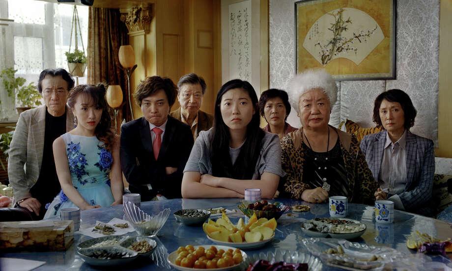 """From left, Jiang Yongbo, Aoi Mizuhara, Chen Han, Tzi Ma, Awkwafina, Li Xiang, Lu Hong and Diana Lin in """"The Farewell."""" Photo: A24 / A24"""