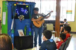 Joe's Puppet Show/Storytime Thing hold a performance for the children staying at the Holding Institute Community Center, Tuesday, Jul. 16, 2019.