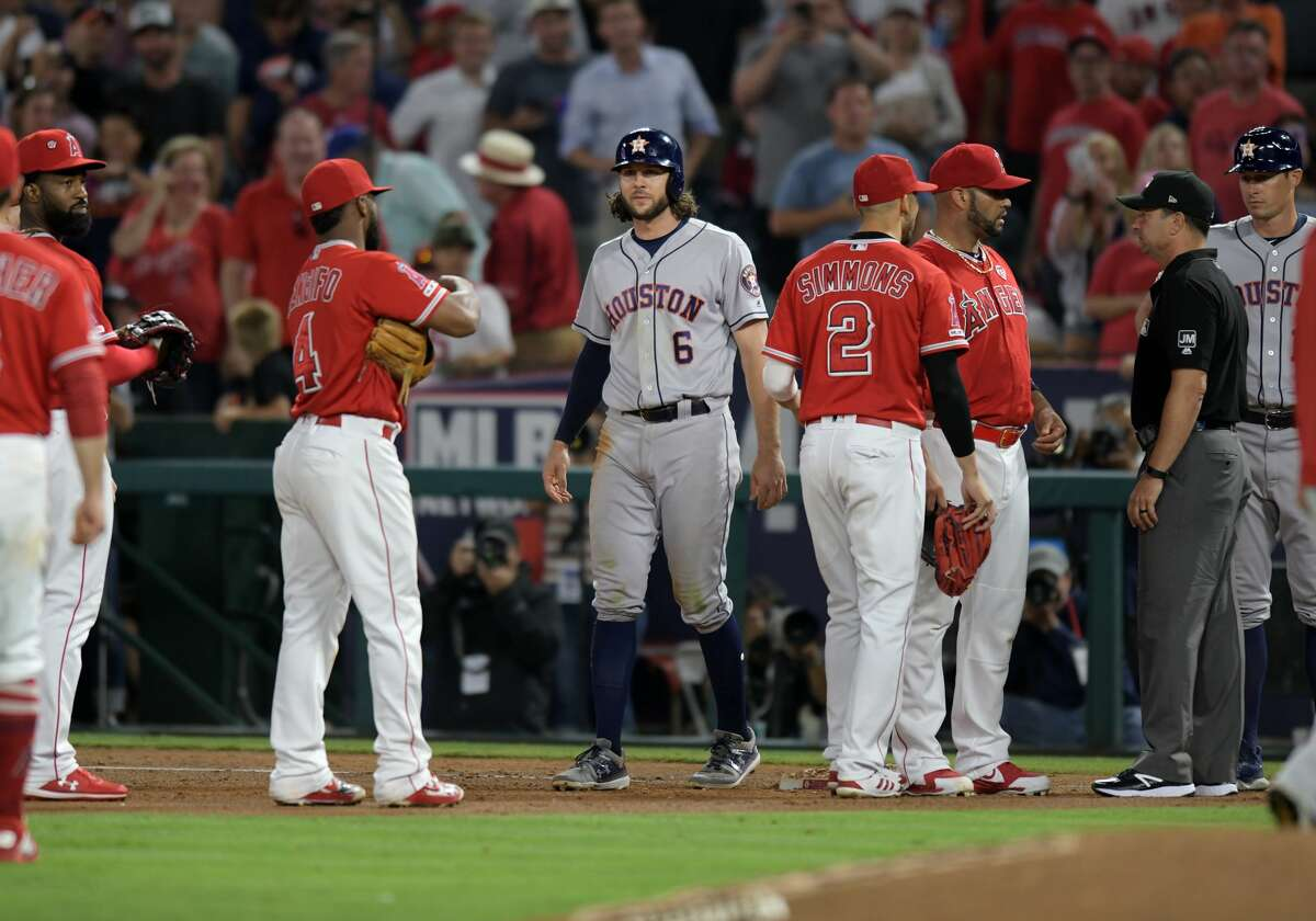 ANAHEIM, CA - JULY 16: Houston Astros center fielder Jake Marisnick (6) at first base in the middle of Los Angeles Angels players after Marisnick was hit by a pitch in the sixth inning of a game played on July 16, 2019 at Angel Stadium of Anaheim in Anaheim, CA. (Photo by John Cordes/Icon Sportswire via Getty Images)