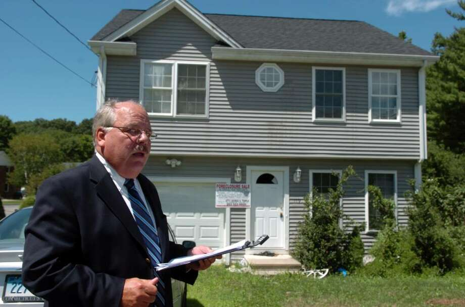 Attorney George Temple oversees a public foreclosure auction Saturday July 31, 2010 at the Shelton home of Faisal Shahzad, who pleaded guilty last month to trying to detonate a car bomb in New York's Times Square. Photo: Autumn Driscoll / Connecticut Post