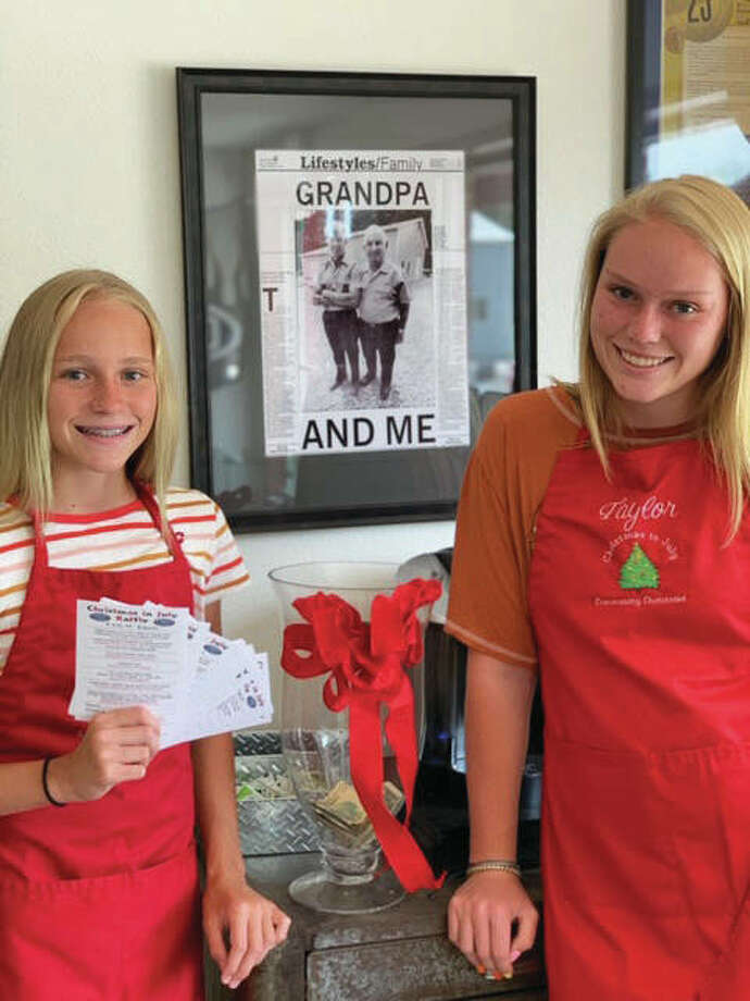 Lily Freer, left, 12, holding this year's Christmas in July's raffle tickets, stands next to her sister, Taylor, 15. Both are wearing Christmas in July aprons for the Friday event, 10:30 a.m. to 1:30 p.m., at Freer Auto Body in Godfrey. All of the event's proceeds go toward Community Christmas, a Riverbend-wide outreach program sponsored by the United Way and The Telegraph. Photo: For The Telegraph