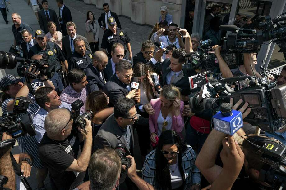 """NEW YORK, NY - JULY 17: Emma Coronel Aispuro, wife of Joaquin """"El Chapo"""" Guzman, is swarmed by press as she leaves federal court, July 17, 2019 in the Brooklyn borough of New York City. El Chapo was sentenced to life in prison after being found guilty on all charges in a drug conspiracy trial. (Photo by Drew Angerer/Getty Images) Photo: Drew Angerer, Staff / Getty Images / 2019 Getty Images"""