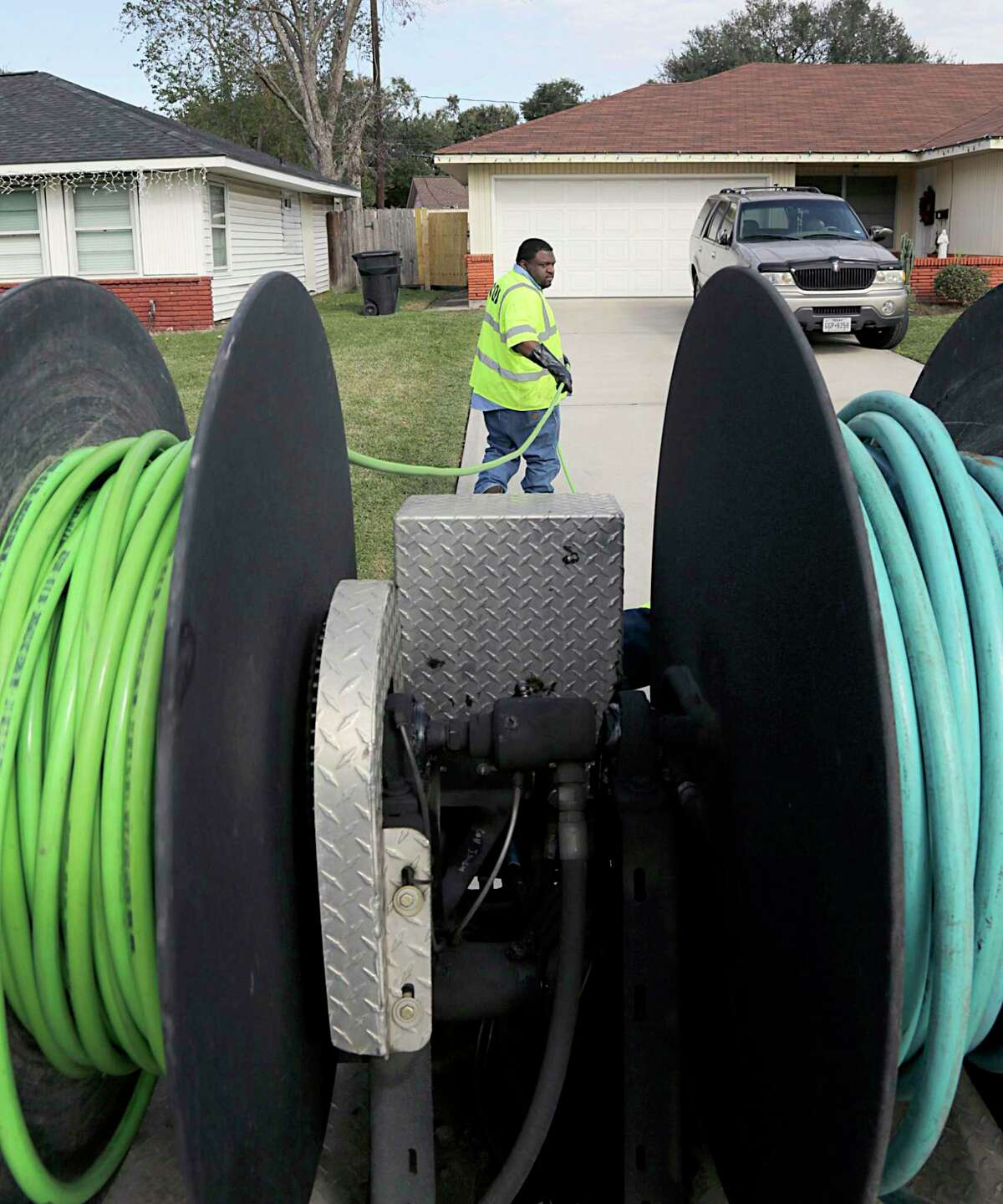 A Houston utility worker unspools a water jet while clearing a sewer blockage in 2016. City council on Wednesday delayed a vote on a proposed $2 billion settlement with federal and state regulators that would accelerate upgrades to the city's struggling sewer system over the next 15 years. ( James Nielsen / Houston Chronicle )