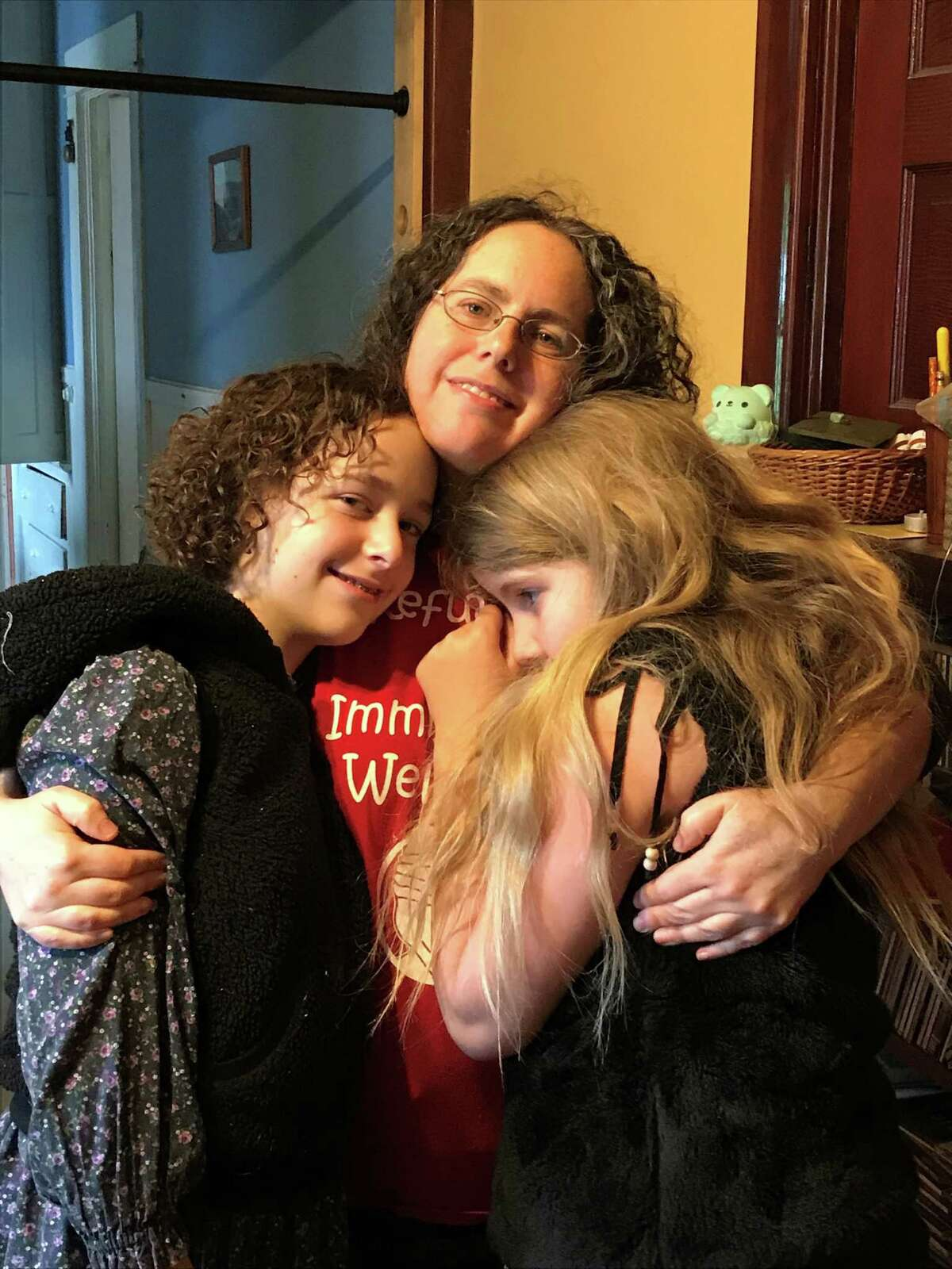 Albany local Miriam Axel-Lute with her daughters Nadia Tell 13, on left, Molly Tell, 9, right, in an undated photo. Axel-Lute traveled alone to participate in Never Again Action protests against migrant detention centers in Washington D.C. on July 16, 2019.