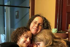 Albany local Miriam Axel-Lute with her daughtersNadia Tell 13, on left, Molly Tell, 9, right, in an undated photo. Axel-Lute traveled alone to participate in Never Again Action protests against migrant detention centers in Washington D.C. on July 16, 2019.