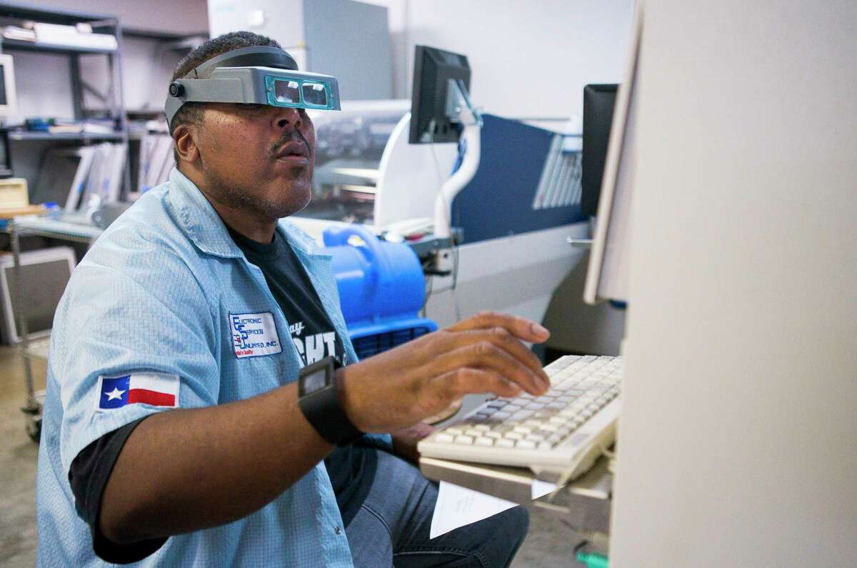 Eric Shackleford programs a pick and place machine at Electronic Services Unlimited, Inc. the Spring Branch area of Houston, Tuesday, July 16, 2019. The company has been watching the prices on many of the components they use rise 25 percent because of tariffs on parts from China.