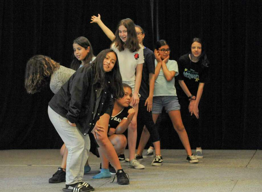 "The Triple Threat Performer camp at The Palace theater in Stamford, Conn. on July 16, 2019. Aspiring performers from across Fairfield and Westchester (NY) Counties, immerse themselves in the exciting process of dance, acting, and voice in a intensive two week course directed by Luis Salgado, assistant choreographer of the Tony-winning ""In the Heights"" and choreographer for Nickelodeon. Part of The Palace's Arts Education program, Triple Threat is in its ninth year. Photo: Matthew Brown / Hearst Connecticut Media / Stamford Advocate"
