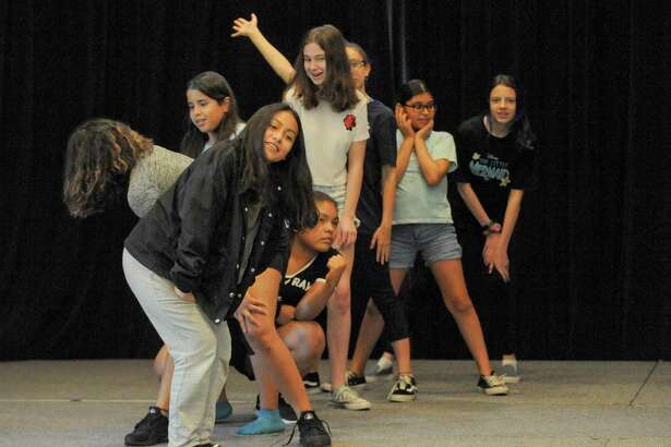 """The Triple Threat Performer camp at The Palace theater in Stamford, Conn. on July 16, 2019. Aspiring performers from across Fairfield and Westchester (NY) Counties, immerse themselves in the exciting process of dance, acting, and voice in a intensive two week course directed by Luis Salgado, assistant choreographer of the Tony-winning """"In the Heights"""" and choreographer for Nickelodeon. Part of The Palace's Arts Education program, Triple Threat is in its ninth year."""