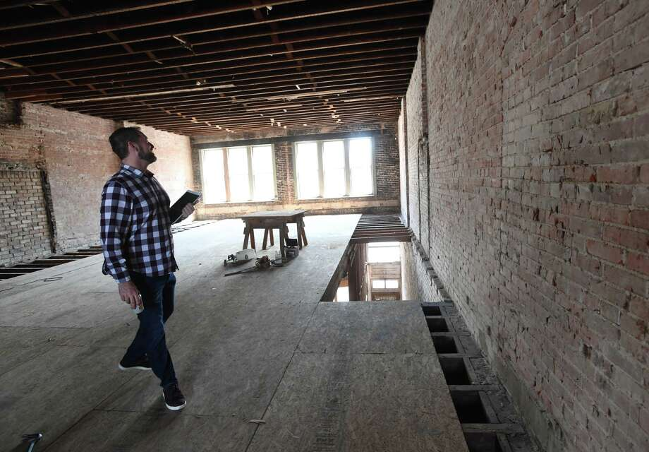 Ed Sturrock gives a tour of the downtown Beaumont building that is being renovated to house the tech company Americommerce. Located at 268 Pearl, the project is expected in be in operation from by year's end.