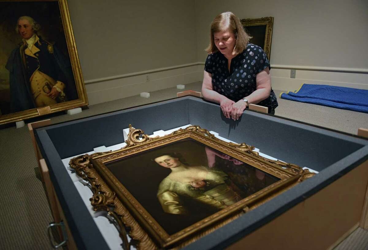 Albany Institute of History & Art curator Diane Shewchuk with the portrait of Mrs. Philip John Schuyler (1734-1803) [Catharine Van Rensselaer Schuyler] on loan from The New-York Historical Society, New York (Thomas McIlworth, 1762-1767, oil on canvas, Bequest of Philip Schuyler, 1915.11) for The Schuyler Sisters and Their Circle exhibit at Albany Institute of History and Art on Friday, July 12, 2019 in Albany, N.Y. (Lori Van Buren/Times Union)