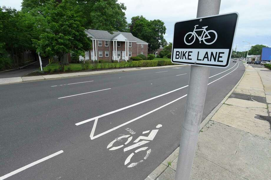 The City of Stamford has implemented dedicated bicycle lanes, such as this one on Summer Street near Bulls Head Corner, shown in a photograph taken on June 21, 2019. Photo: Matthew Brown / Hearst Connecticut Media / Stamford Advocate