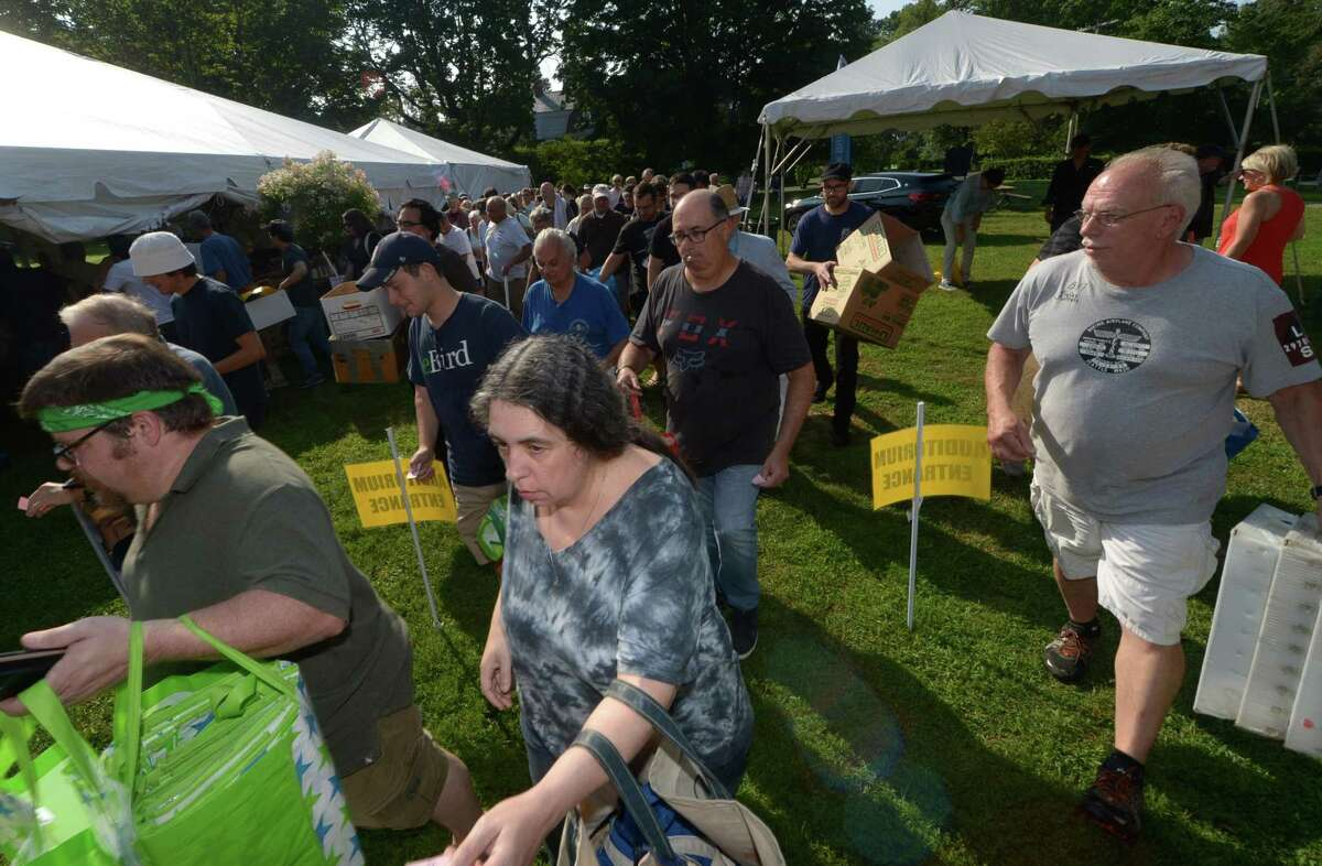 Early birds rush into The Pequot Library's 58th Summer Book Sale last year. The event returns July 26-30. Proceeds directly fund Pequot Library's annual programs and events for all ages.