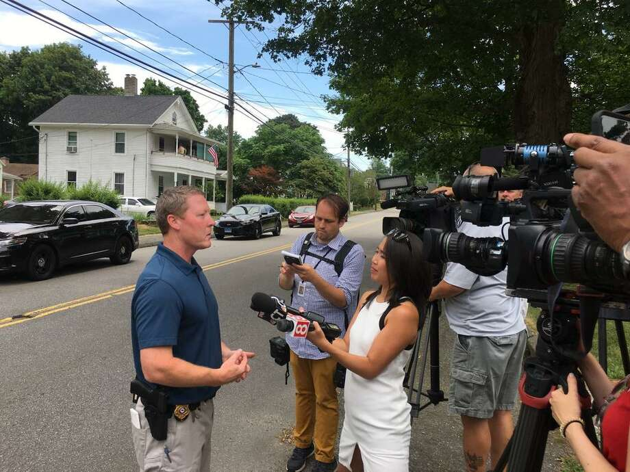 Police speak to the media after the body of a man was pulled from the Naugatuck River in Torrington. Photo: Lara Green-Kazlauskas