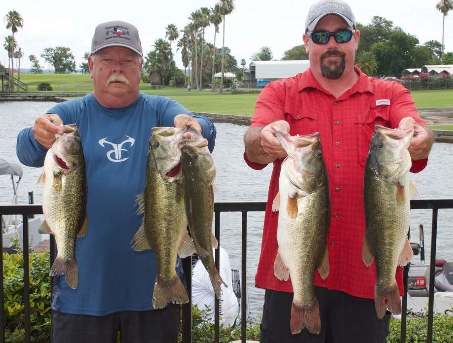 Garrett Pierce and Harlan Blancet came in first place in the CONROEBASS Mid-Day Madness Tournament with a stringer weighing 22.33 pounds. Photo: Conroe Bass