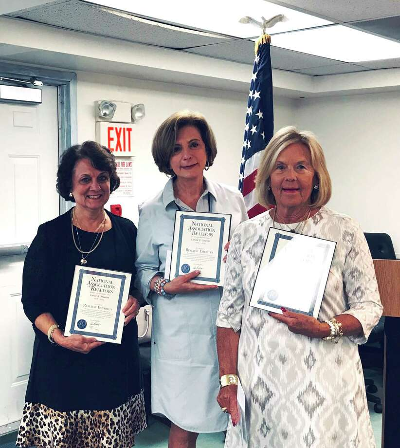 The Ridgefield Board of Realtors recognized four of its members, Carole Cousins, Carol Hanlon, Ellen Stueck and Virginia Beasley (not pictured) at their Town and State Legislative Update meeting on Wednesday for achieving the prestigious Realtor Emeritus status. Photo: Contributed Photo