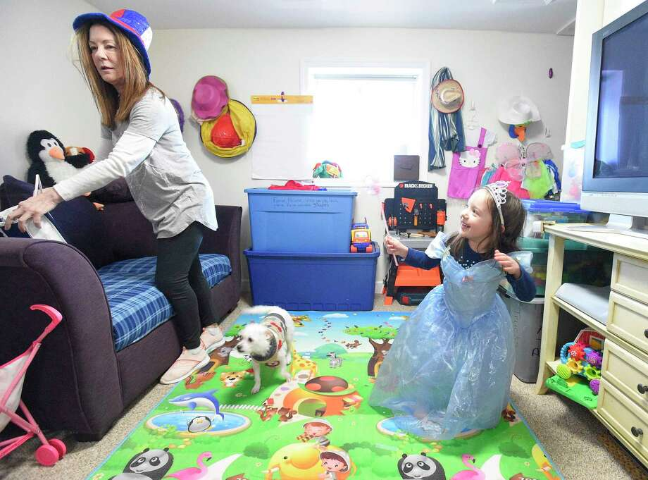 Debbie Eposito plays dress up with Alessandra Palma, 3 1/2, at her childcare business she runs out of her Stamford home on Tuesday, Feb. 5, 2019. Eposito, a family child care provider, is unable to hire help due to changes in Connecticut Child Care legislation and delays in state background and fingerprinting checks. She can only care for up to six children in her private home business, Beginner Steps daycare in Stamford, Connecticut. Photo: Matthew Brown / Hearst Connecticut Media / Stamford Advocate