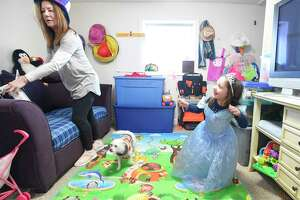 Debbie Eposito plays dress up with Alessandra Palma, 3 1/2, at her childcare business she runs out of her Stamford home on Tuesday, Feb. 5, 2019. Eposito, a family child care provider, is unable to hire help due to changes in Connecticut Child Care legislation and delays in state background and fingerprinting checks. She can only care for up to six children in her private home business, Beginner Steps daycare in Stamford, Connecticut.