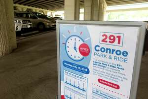 A sign for Metro stop 291 is seen at a station stop under I-45 near FM 2854, Tuesday, July 16, 2019, in Conroe. The Conroe Commuter Connection bus transports residents from Conroe to various locations around downtown Houston.