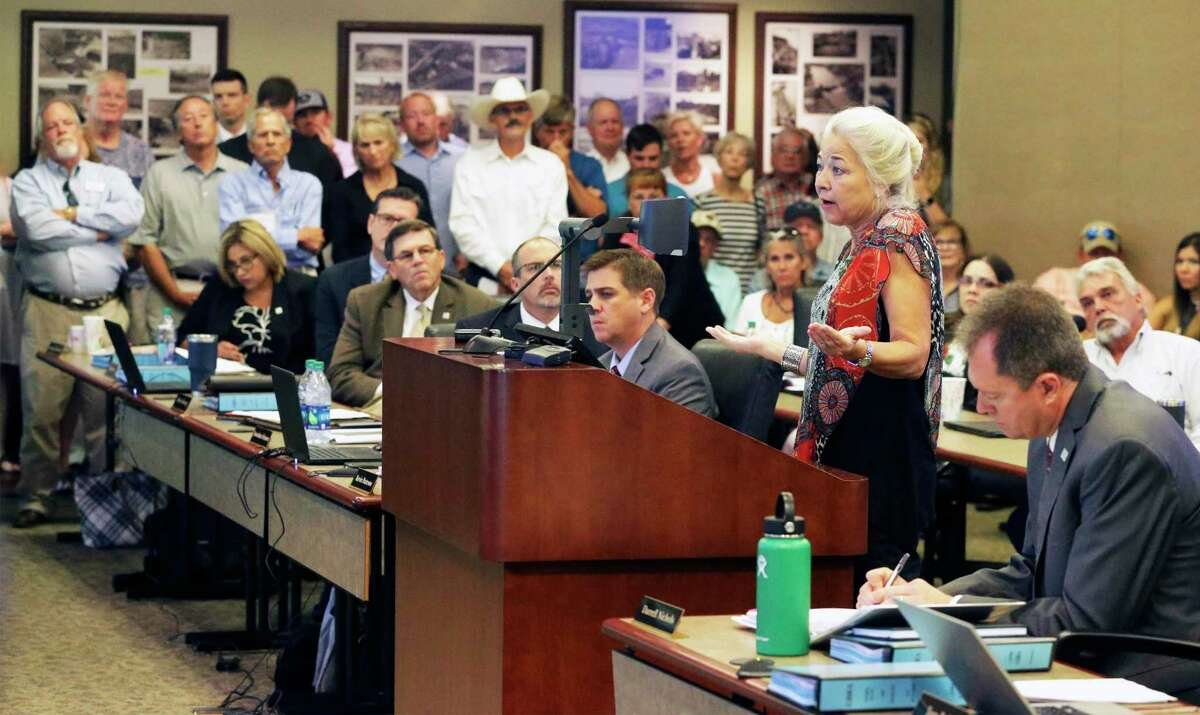 Tonya Mallory, a resident of Lake Dunlap, addresses the Guadalupe-Blanco River Authority board as area residents voice their concerns about the future of the lakes on the Guadalupe during a meeting July 17, 2019.