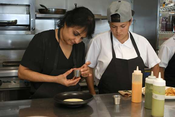 Owner and chef Heena Patel (left) and chef Jessica Hernandez (right) work in the kitchen at Besharam, a new Gujarati (West Indian) restaurant on Thursday, Aug. 16, 2018 in San Francisco, Calif.