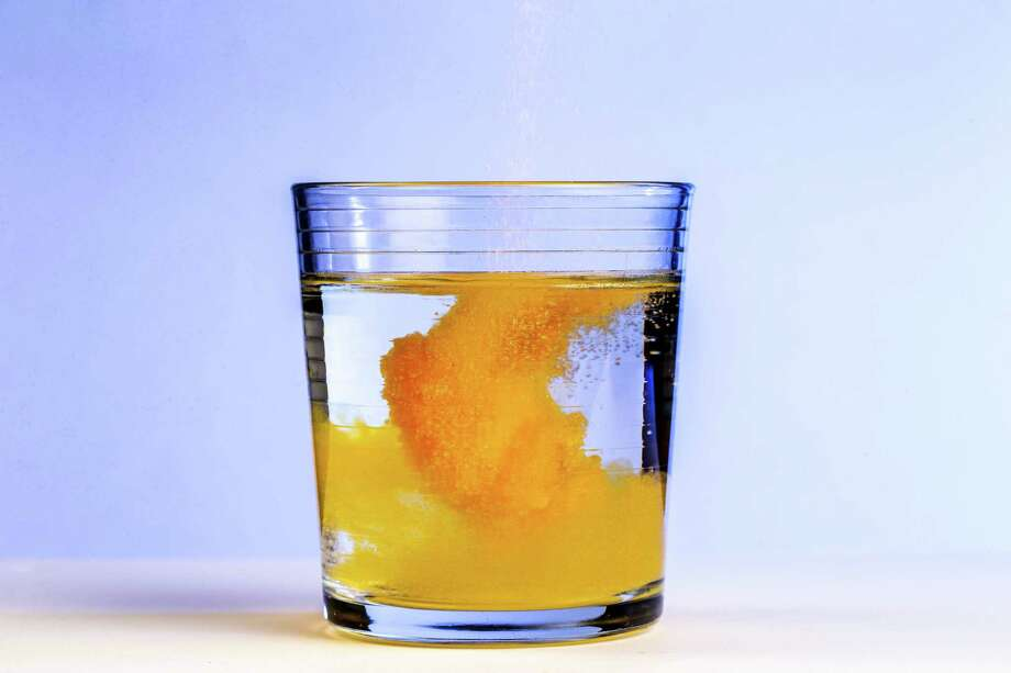 Two full tablespoons of sugary powder are called for to make one eight-ounce glass of Tang, with natural flavor and the artificial colors that make it glow a lurid tangerine accounting for less than 2% of the mix. (Bettina Hansen/The Seattle Times/TNS) Photo: Bettina Hansen / Seattle Times