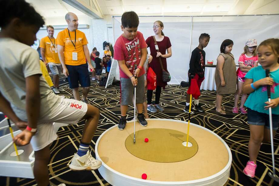 Children play mini golf during the STEM in Sports event on Wednesday, July 17, 2019 at the Midland Country Club. For more photos, go to www.ourmidland.com. (Katy Kildee/kkildee@mdn.net) Photo: (Katy Kildee/kkildee@mdn.net)