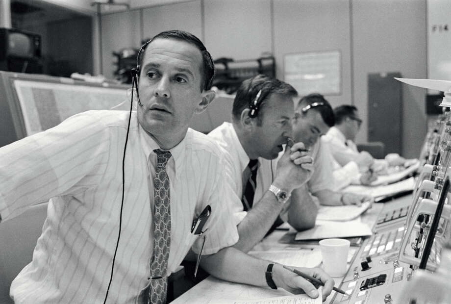 "Astronaut Charles M. Duke Jr. and other flight controllers monitor Apollo 11 during tense moments July 20, 1969. Duke's first words to the crew ended with, ""Tranquility, we copy you on the ground. You got a bunch of guys about to turn blue. We're breathing again. Thanks a lot!"" (NASA)"