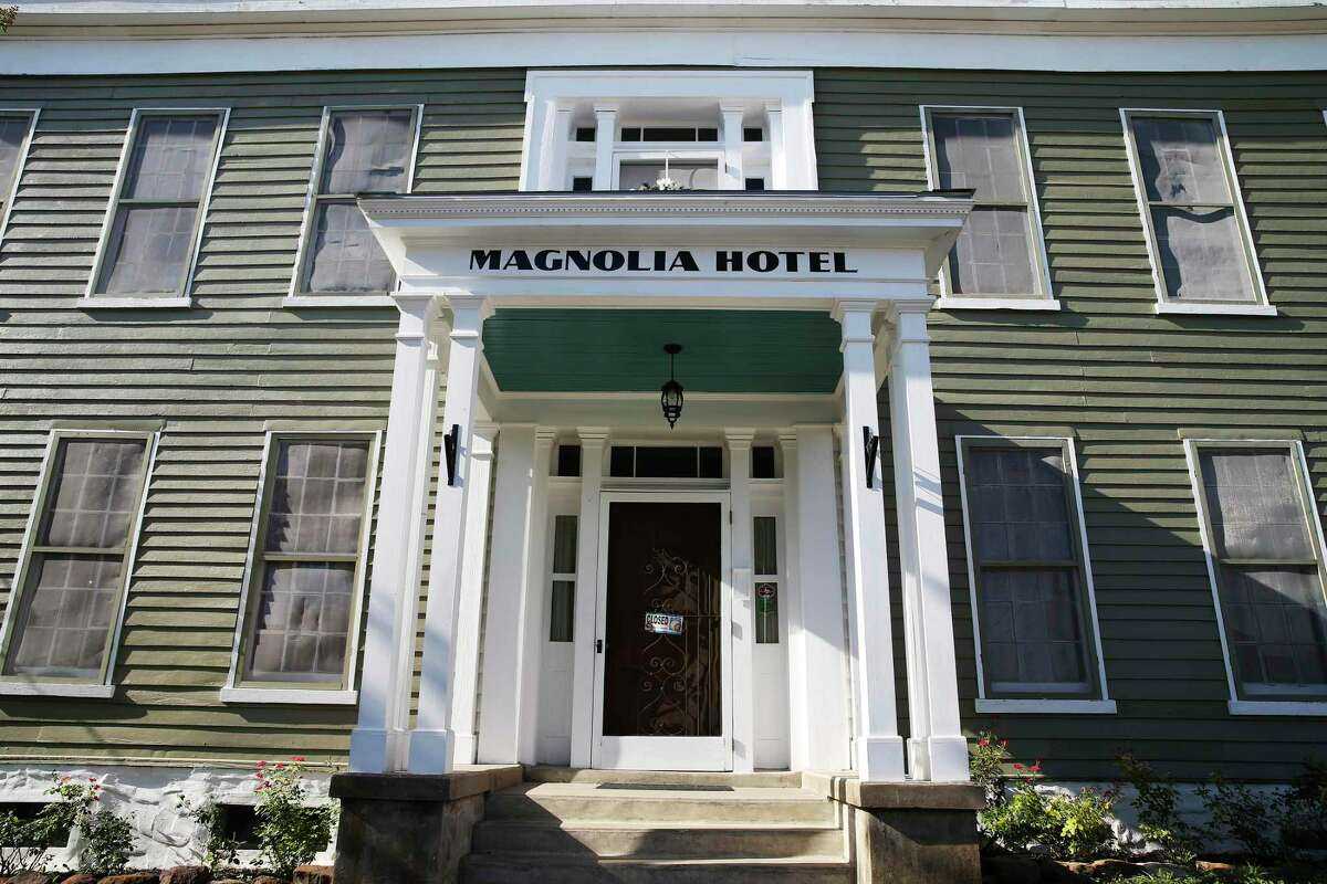 A view of the main entrance of the Magnolia Hotel in Seguin, Texas, Thursday, July 11, 2019. Erin Ghedi and her husband, Jim, bought the hotel in 2013.
