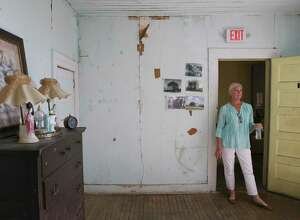 Erin Ghedi talks about the paranormal activity at the Magnolia Hotel in Seguin, Texas, Thursday, July 11, 2019. Ghedi and her husband, Jim, bought the hotel in 2013.