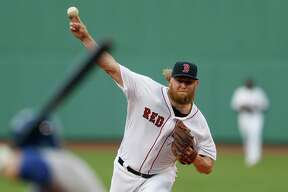 Boston Red Sox's Andrew Cashner pitches during the first inning of a baseball game against the Toronto Blue Jays in Boston, Tuesday.