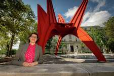 Mary Donegan, an urban planner and teacher at the University of Connecticut in Storrs, stands near Alexander Calder's Stegosaurus sculpture in Hartford's Burr Mall on Friday, July 12, 2019.